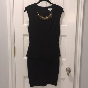 Black peplum Bisou Bisou dress